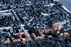 The University facilities at Röntgenring, color-highlighted on a historical aerial photograph.