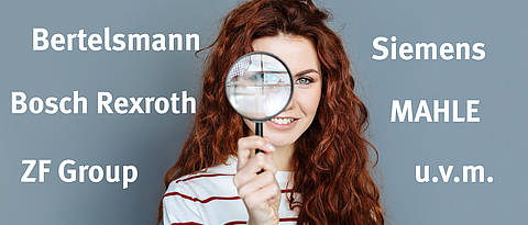 Laboratory equipment. Close up of magnifying glass being in hands of a cheerful smart red haired woman while doing a research