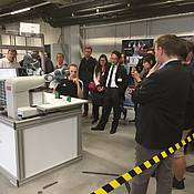 Conference excursion to ZfT showing advanced satellite production supported by robots, applying force feedback for integration